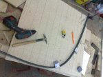 plastic batten providing a smooth curve from the marked offsets