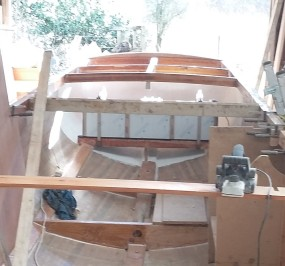 The rear deck beams in place with the fuel tank strapped to its bearers.