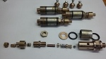 A full kit of parts for one valve, and three (un-hexagoned ones)