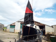 A bow view of a semi-rigged sail...